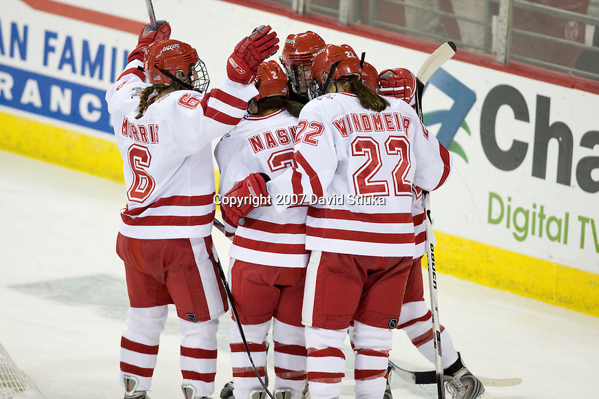 MADISON, WI - NOVEMBER 2: The Wisconsin Badgers women's hockey team celebrates a goal against the Minnesota Golden Gophers at the Kohl Center on November 2, 2007, in Madison, Wisconsin. The Badgers beat the Golden Gophers 3-0. (Photo by David Stluka)