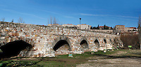 "Panoramic view of Roman Bridge, Salamanca, Spain, pictured on December 18, 2010 in the afternoon. The 356 meter Roman Bridge, which has 15 granite stone arches,  leads across the Tormes River to Salamanca. It was built in 89AD, and restored in the 17th century after flood damage. Salamanca, an important Spanish University city, is known as La Ciudad Dorada (""The golden city"") because of the unique golden colour of its Renaissance sandstone buildings. Founded in 1218 its University is still one of the most important in Spain. Around it the Old Town is a UNESCO World Heritage Site. Picture by Manuel Cohen"