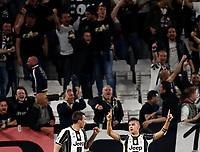 Football Soccer: UEFA Champions UEFA Champions League quarter final first leg Juventus-Barcellona, Juventus stadium, Turin, Italy, April 11, 2017. <br /> Juventus Paulo Dybala (r) celebrates with his teammate Mario Mandzukic (l) after scoring during the Uefa Champions League football match between Juventus and Barcelona at the Juventus stadium, on April 11 ,2017.<br /> UPDATE IMAGES PRESS/Isabella Bonotto