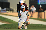 Lee Westwood lines up his putt with his caddy Billy Foster on the 18th green during the Final Day of the Dubai World Championship, Earth Course, Jumeirah Golf Estates, Dubai, 28th November 2010..(Picture Eoin Clarke/www.golffile.ie)