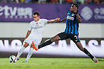 (L) Lucas Vazquez of Real Madrid CF being followed by (R) Geoffrey Kondogbia of FC Internazionale Milano during the FC Internazionale Milano vs Real Madrid  as part of the International Champions Cup 2015 at the Tianhe Sports Centre on 27 July 2015 in Guangzhou, China. Photo by Hendrik Frank / Power Sport Images