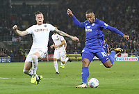 Kenneth Zohore of Cardiff City is marked by Pontus Jansson of Leeds United during the Sky Bet Championship match between Cardiff City and Leeds United at The Cardiff City Stadium, Cardiff, Wales, UK. Tuesday 26 September 2017