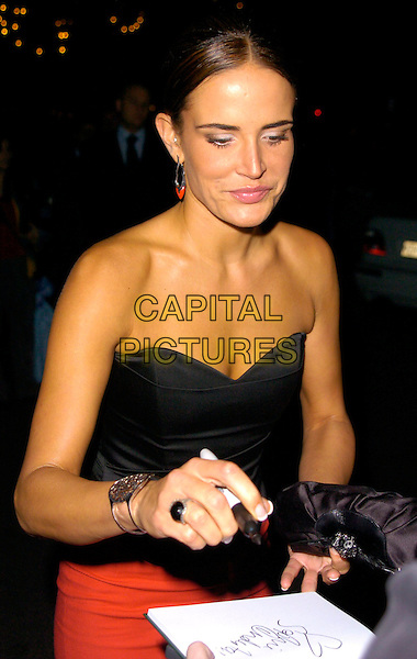 SOPHIE ANDERTON.The Gina Shoes 50th Anniversary Party, Dorchester Hotel, London, UK..September 19th, 2006.Ref: CAN.half length black strapless top signing autograph.www.capitalpictures.com.sales@capitalpictures.com.©Can Nguyen/Capital Pictures