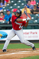Oklahoma City Redhawks first baseman Jonathan Singleton #24 swings the bat during the Pacific Coast League baseball game against the Round Rock Express on April 3, 2014 at the Dell Diamond in Round Rock, Texas. The Redhawks defeated the Express 7-6 in the season opener for both teams. (Andrew Woolley/Four Seam Images)