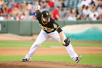 Jeremy Berg (25) of the Salt Lake Bees delivers a pitch to the plate against the Tacoma Rainiers in Pacific Coast League action at Smith's Ballpark on July 8, 2014 in Salt Lake City, Utah.  (Stephen Smith/Four Seam Images)