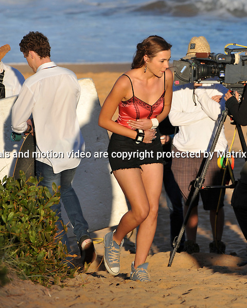 23rd September, 2014 SYDNEY AUSTRALIA<br /> non EXCLUSIVE <br /> Pictured, Alec Snow and Demi Harman , cast members of Home and Away doing scenes at the Palm Beach Surf Club, Palm Beach, NSW. <br /> <br /> *No internet without clearance*.MUST CALL PRIOR TO USE +61 2 9211-1088. Matrix Media Group.Note: All editorial images subject to the following: For editorial use only. Additional clearance required for commercial, wireless, internet or promotional use.Images may not be altered or modified. Matrix Media Group makes no representations or warranties regarding names, trademarks or logos appearing in the images.