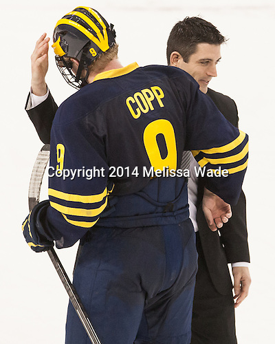 Andrew Copp (Michigan - 9), Mike Ayers (BC - Assistant Coach) - The Boston College Eagles defeated the visiting University of Michigan Wolverines 5-1 (EN) on Saturday, December 13, 2014, at Kelley Rink in Conte Forum in Chestnut Hill, Massachusetts.