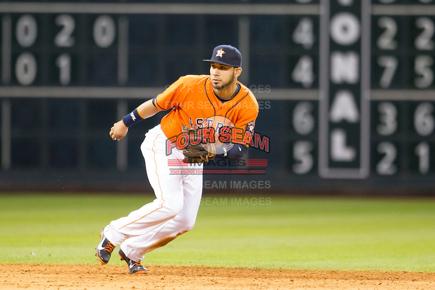 Houston Astros shortstop Marwin Gonzalez (9) on defense during the MLB baseball game against the Detroit Tigers on May 3, 2013 at Minute Maid Park in Houston, Texas. Detroit defeated Houston 4-3. (Andrew Woolley/Four Seam Images).