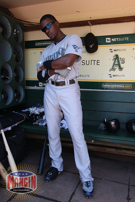 OAKLAND, CA - AUGUST 18:  Fred Lewis #15 of the Toronto Blue Jays gets ready in the dugout before the game against the Oakland Athletics at the Oakland-Alameda County Coliseum on August 18, 2010 in Oakland, California. Photo by Brad Mangin
