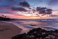 Colorful sunset at Three Tables Beach, North Shore, O'ahu.