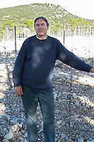 Christian Mocci Domaine de Mas de Martin, St Bauzille de Montmel. Gres de Montpellier. Languedoc. Owner winemaker. In the vineyard. France. Europe. Mountains in the background.