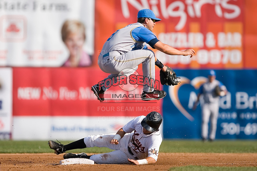 Shortstop Brandon Hicks (8) of the Myrtle Beach Pelicans leaps over a sliding Danny Figueroa (2) of the Frederick Keys to complete a double play at Harry Grove Stadium in Frederick, MD, Monday July 14, 2008. (Photo by Brian Westerholt / Four Seam Images)