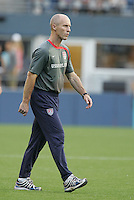 Bob Bradley walks onto the field at half time. USA defeated Grenada 4-0 during the First Round of the 2009 CONCACAF Gold Cup at Qwest Field in Seattle, Washington on July 4, 2009.