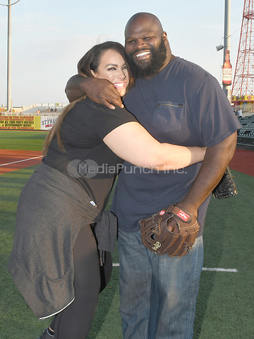 Brooklyn, NY - AUGUST 17: WWE Superstars  Mark Henry and Nia Jax visits MCU Park in Brooklyn, New York on August 17, 2017 during Summer Slam Week. Photo Credit: George Napolitano/MediaPunch