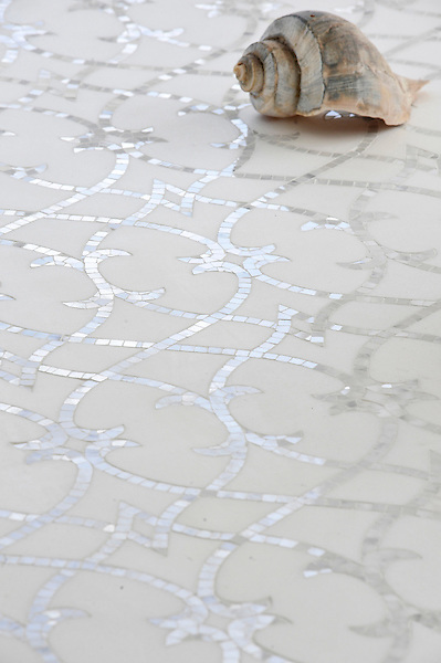 Avila, a handmade mosaic shown in honed Thassos and polished Statuarietto, is part of the Miraflores collection by Paul Schatz for New Ravenna.