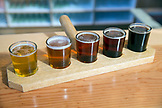 USA, Oregon, Ashland, a sample of beers brewed at the Caldera Brewery and Restaurant which includes lawnmower lager, dry hop orange, dry hop red, douple hemp brown and pilot rock porter