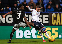 Bolton Wanderers' Craig Noone crosses under pressure from Reading's Andy Yiadom  <br /> <br /> Photographer Andrew Kearns/CameraSport<br /> <br /> The EFL Sky Bet Championship - Bolton Wanderers v Reading - Tuesday 29th January 2019 - University of Bolton Stadium - Bolton<br /> <br /> World Copyright © 2019 CameraSport. All rights reserved. 43 Linden Ave. Countesthorpe. Leicester. England. LE8 5PG - Tel: +44 (0) 116 277 4147 - admin@camerasport.com - www.camerasport.com
