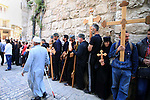 Christian Orthodox pilgrims participate in a procession marking Good Friday on April 18, 2014 in Jerusalem's old city. Thousands of Christian pilgrims take part in processions along the route where, according to tradition, Jesus Christ carried the cross during his last days, as Christians around the world mark the Holy Week, commemorating the crucifixion of Jesus Christ, leading up to his resurrection on Easter. Photo by Saeed Qaq