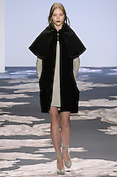 Model walks runway in an outfit from the Vera Wang Fall 2013 collection, during Mercedes-Benz Fashion Week New York Fall 2013.