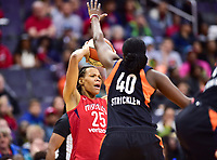 Washington, DC - June 3, 2018: Washington Mystics forward Monique Currie (25) is defended by Connecticut Sun guard Shekinna Stricklen (40) during game between the Washington Mystics and Connecticut Sun at the Capital One Arena in Washington, DC. (Photo by Phil Peters/Media Images International)