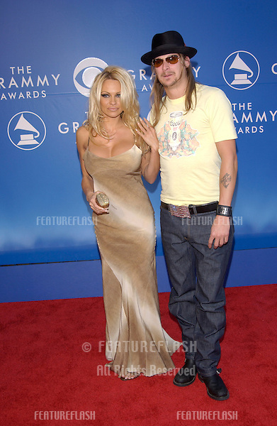 Actress PAMELA ANDERSON & rock star boyfriend KID ROCK at the 2002 Grammy Awards in Los Angeles.