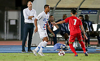 GEORGETOWN, GRAND CAYMAN, CAYMAN ISLANDS - NOVEMBER 19: Reggie Cannon #20 of the United States moves with the ball looks for an open man downfield during a game between Cuba and USMNT at Truman Bodden Sports Complex on November 19, 2019 in Georgetown, Grand Cayman.