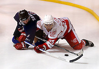 Ryan Blackwood (R) of Haringey tussles with a Slough player during the National Ice Hockey League South Division 2 Cup - Group B game between Haringey Racers and Slough Jets at Alexandra Palace, London on Sat Sept 13, 2014.