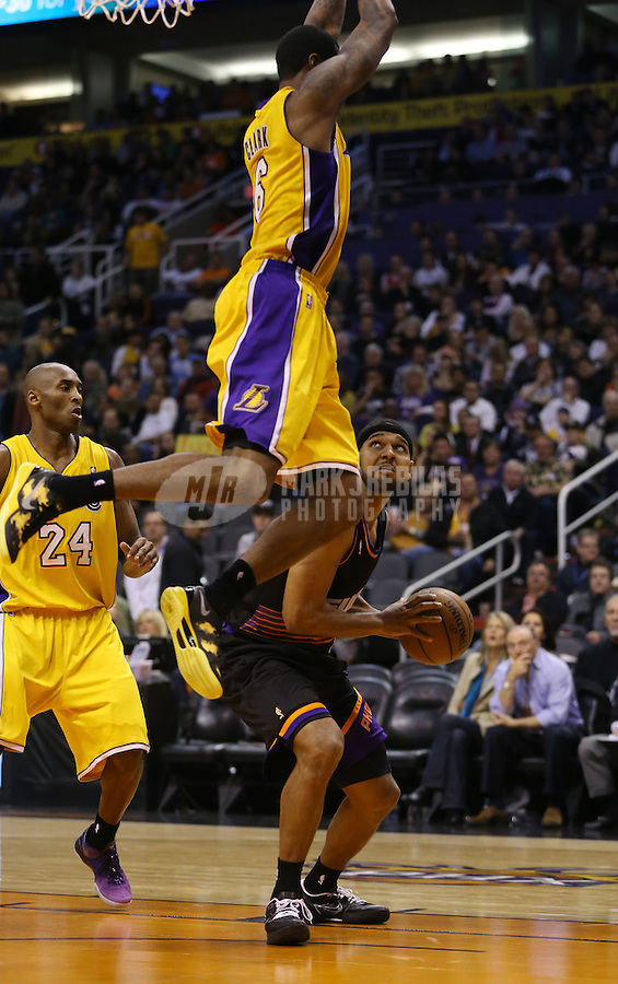 Jan. 30, 2013; Phoenix, AZ, USA: Los Angeles Lakers forward Earl Clark flies through the air as he fouls Phoenix Suns forward Jared Dudley at the US Airways Center. Mandatory Credit: Mark J. Rebilas-