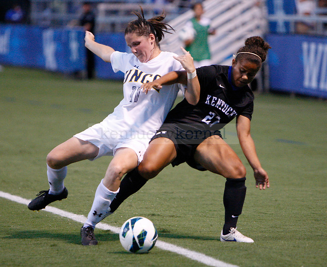 Senior forward Kirsten Robinson is pushed out of bounds at Women's Soccer vs. UNC Greensboro at the UK Soccer Complex in Lexington, Ky., on Friday, August 31, 2012. Photo by Tessa Lighty | Staff