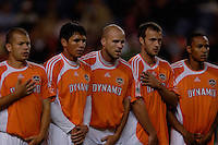 The Houston Dynamo defensive wall of Alejandro Moreno, Brian Ching, Craig Waibel, Eddie Robinson and Ricardo Clark, prepare for the imminent freekick. The Houston Dynamo beat the Colorado Rapids 1-0 on a goal by Brian Ching, April 29, 2006, at Invesco Field at Mile High Stadium in Denver, Colorado.