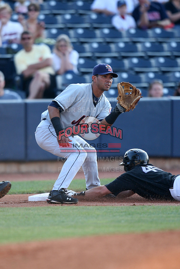 Binghamton Mets Third Baseman Jose Coronado (8) gets the throw as Tim Fedroff slides in during a game vs. the Akron Aeros at Eastwood Field in Akron, Ohio;  June 25, 2010.   Binghamton defeated Akron 5-3.  Photo By Mike Janes/Four Seam Images