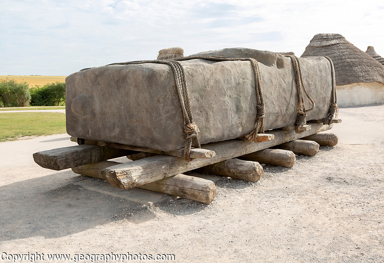 Replica of giant stone megalith on wooden rollers Stonehenge, Wiltshire, England, UK