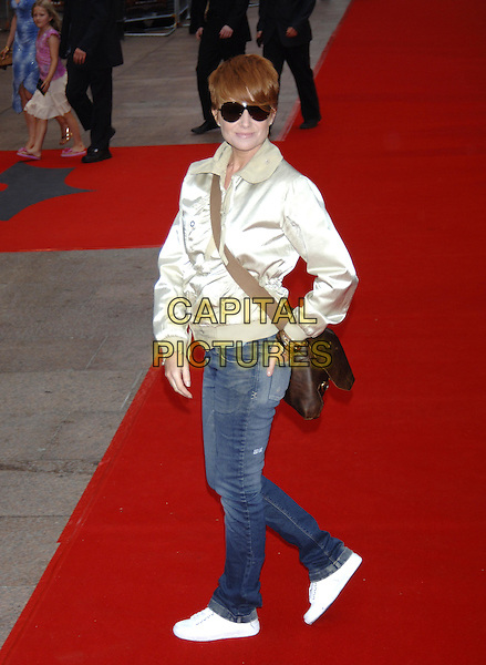 "PATSY PALMER.European Film Premiere of ""Batman Begins"",.Odeon Cinema, Leicester Square, London, .June 12th 2005..full length gold satin jacket jeans white trainers black aviator sunglasses.Ref: PL.www.capitalpictures.com.sales@capitalpictures.com.©Capital Pictures"