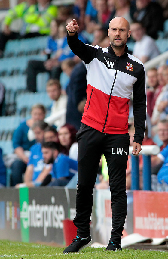 Swindon Town manager Luke Williams shouts instructions to his team from the dug-out<br /> <br /> Photographer David Shipman/CameraSport<br /> <br /> The EFL Sky Bet League One - Peterborough v Swindon Town - Saturday 3 September 2016 -  ABAX Stadium - Peterborough<br /> <br /> World Copyright &copy; 2016 CameraSport. All rights reserved. 43 Linden Ave. Countesthorpe. Leicester. England. LE8 5PG - Tel: +44 (0) 116 277 4147 - admin@camerasport.com - www.camerasport.com