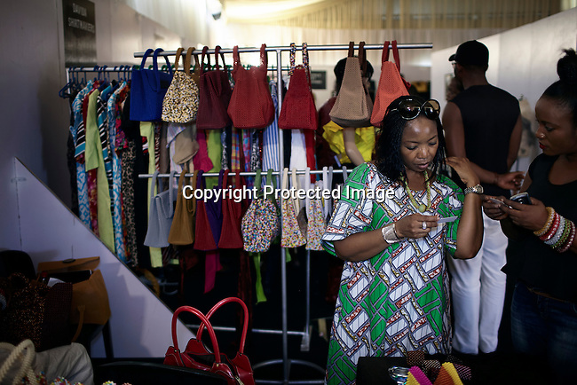 LAGOS, NIGERIA - OCTOBER 26: Designers sell their fashion at a market at Lagos Fashion & Design Week on October 26, 2013 in Lagos, Nigeria. The yearly event gathers local designers and designers to show their latest collections. (Photo by: Per-Anders Pettersson)