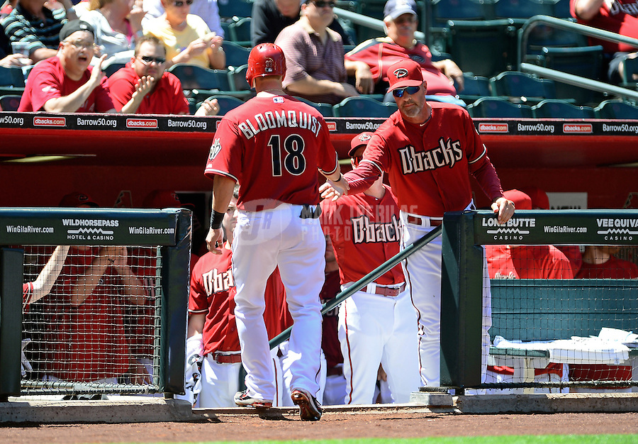 Apr. 18, 2012; Phoenix, AZ, USA; Arizona Diamondbacks base runner Willie Bloomquist (18) is congratulated by manager Kirk Gibson after scoring in the first inning against the Pittsburgh Pirates at Chase Field. Mandatory Credit: Mark J. Rebilas-