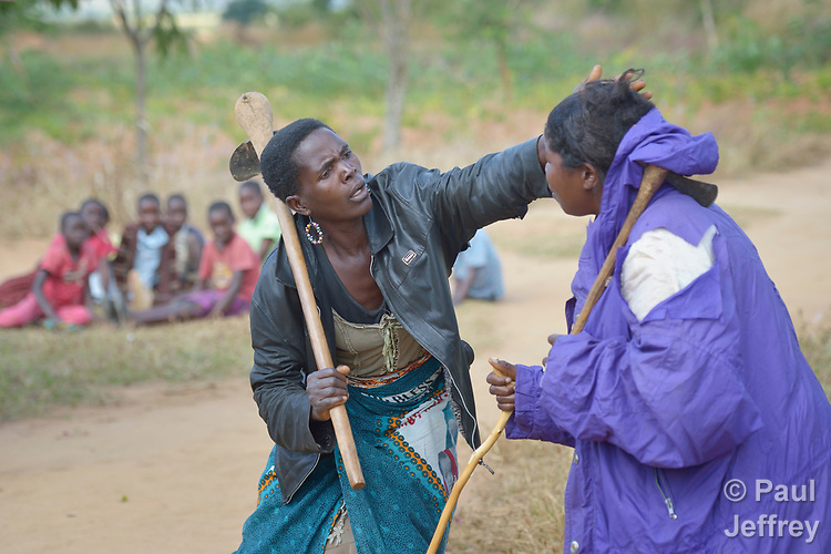 Women participate in an educational drama in Edundu, Malawi. They and other farmers in the village have benefited from intercropping and crop rotation practices they learned from the Malawi Farmer-to-Farmer Agro-Ecology project of the Ekwendeni Mission Hospital AIDS Program, a program of the Livingstonia Synod of the Church of Central Africa Presbyterian.