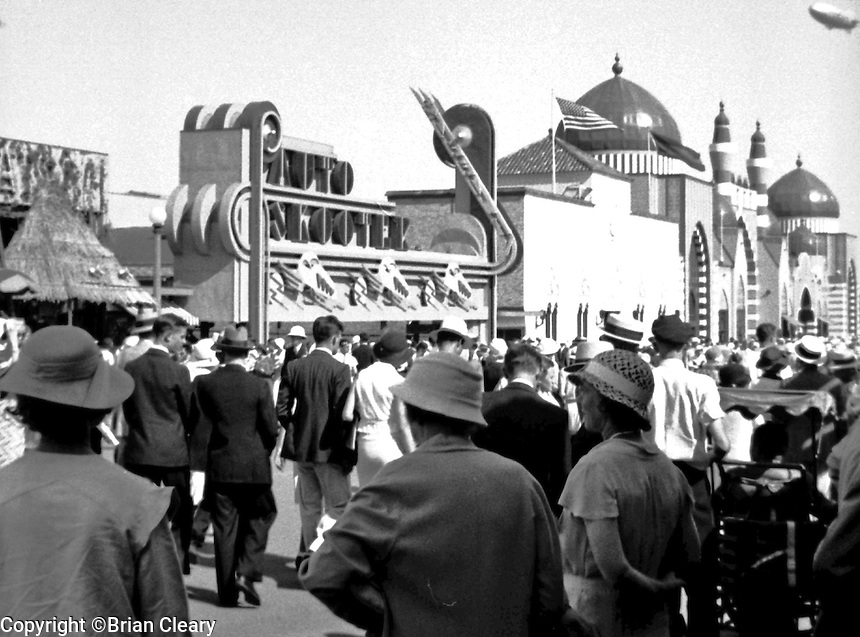 "The Goodyear Blimp flies over a crowded sidewalk in front of the ""Auto Skooter"" at the 1933 Chicago World's Fair.ONE HALF OF STEREO PAIR (Photographer Unknown/www.bcpix.com)"