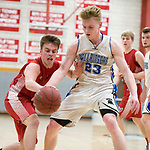 WOLCOTT, CT-031418JS04- Wamogo's Cole Higgins (10) and East Hampton's Zachary Webber (23) battle for a loose ball during their Division V semifinal game Wednesday at Wolcott High School. <br /> Jim Shannon Republican-American