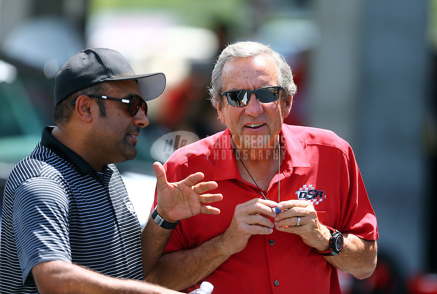 Jun 19, 2016; Bristol, TN, USA; NHRA pro team owner Don Schumacher (right) talks with pro mod driver Khalid Albalooshi during the Thunder Valley Nationals at Bristol Dragway. Mandatory Credit: Mark J. Rebilas-USA TODAY Sports