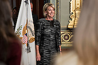 Betsy DeVos, United States Secretary of Education, arrives to be sworn in by U.S. Vice President Mike Pence, not pictured, in the Vice President's Ceremonial Office in Washington, D.C., U.S., on Tuesday, Feb. 7, 2017. DeVos squeaked through a history-making Senate confirmation vote to become U.S. education secretary, as Vice President Mike Pence broke a 50-50 tie and Republicans staved off last-minute defections that would have killed her nomination. Photo Credit: Andrew Harrer/CNP/AdMedia