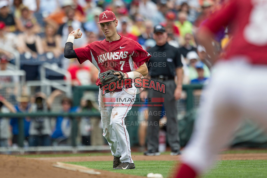 Arkansas Razorbacks third baseman Bobby Wernes (7) makes a throw to first base against the Virginia Cavaliers in Game 1 of the NCAA College World Series on June 13, 2015 at TD Ameritrade Park in Omaha, Nebraska. Virginia defeated Arkansas 5-3. (Andrew Woolley/Four Seam Images)