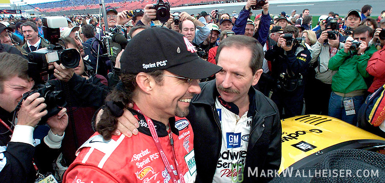 NASCAR drivers Dale Earnhardt Sr (R) talks with Kyle Petty prior to their driving in the 39th Rolex 24 At Daytona in Daytona Beach, Florida February 2, 2001.