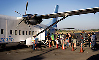 Passengers line up to enter the plane flying to the Caribbean coastal city of Bluefields from Managua, Nicaragua, April, 2009. Travel through the country to the coast is easiest done by plane, but can be passed by bus.