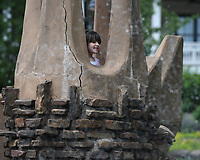 NWA Democrat-Gazette/J.T. WAMPLER Izzy Clardy, 7, calls for her mom Cecillia Clardy of Fayetteville Monday May 3, 2019 while playing on the castle at Wilson Park in Fayetteville. An active spring flows from under the castle that was built in 1981 by artist and sculptor Frank Williams.