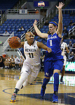 Nevada's Camariah King drives past Air Force defender Cortney Porter during a women's basketball game in Reno, Nev., on Saturday, Jan. 9, 2016. Nevada won 68-57.<br /> Photo by Cathleen Allison