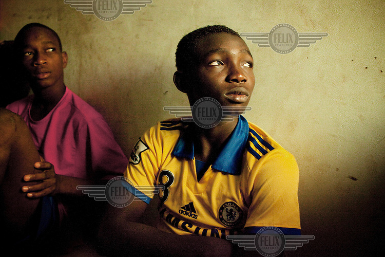 At the JMG football academy in Bamako boys watch a Champions League match on television.