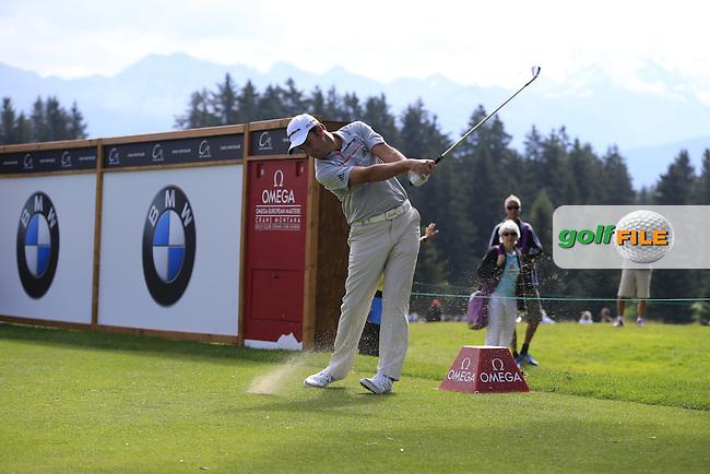 Richard BLAND (ENG) tees off the 11th tee during Thursday's Round 1 of the 2014 Omega European Masters held at the Crans Montana Golf Club, Crans-sur-Sierre, Switzerland.: Picture Eoin Clarke, www.golffile.ie: 4th September 2014