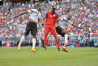 Commerce City, CO - Thursday June 08, 2017: Sheldon Bateau, Jozy Altidore and Daneil Cyrus during their 2018 FIFA World Cup Qualifying Final Round match versus Trinidad & Tobago at Dick's Sporting Goods Park.