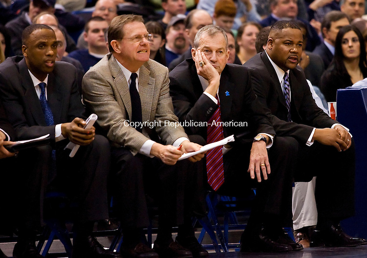 Hartford, CT-13, February 2010-021310CM04   UCONN head coach Jim Calhoun watches in dissapointment as his team fell to Cincinnati 60-48 Saturday afternoon in Hartford.  The Huskies have lost five of their last six games, most of which Calhoun missed while on medical leave.  Flanking him are his assitant coaches, from lefto to right, Patrick Sellers, George Blaney and Andrew LaFleur.     --Christopher Massa Republican-American